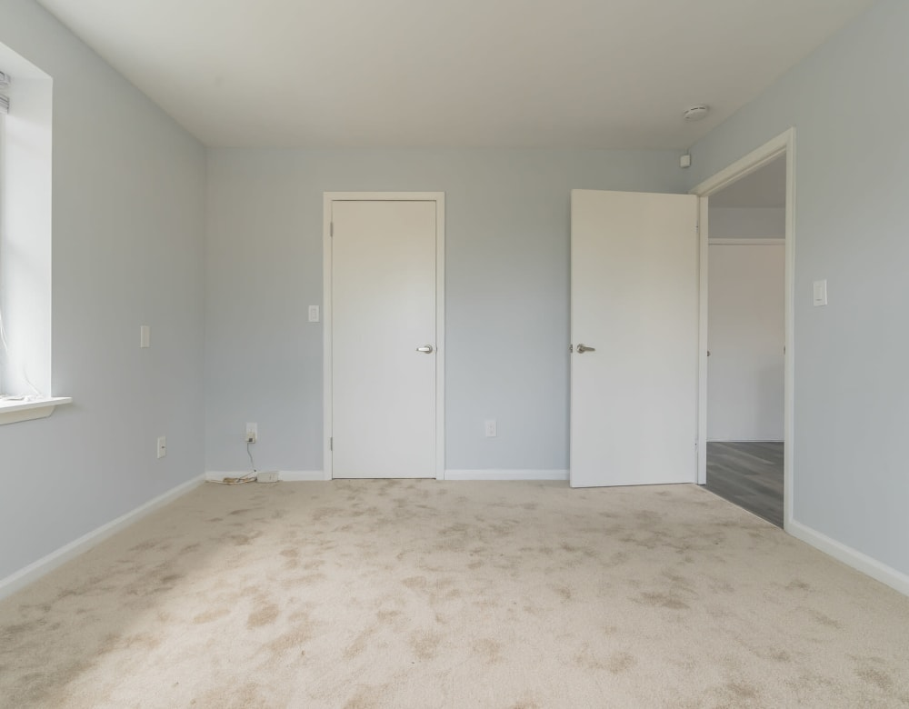 A large bedroom with closet and windows at Bunt Commons I in Lindenhurst, New York