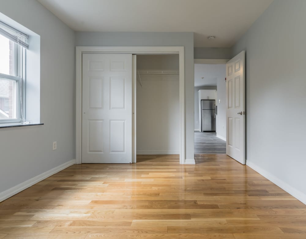 An apartment bedroom with closet at Bunt Commons III in Amityville, New York