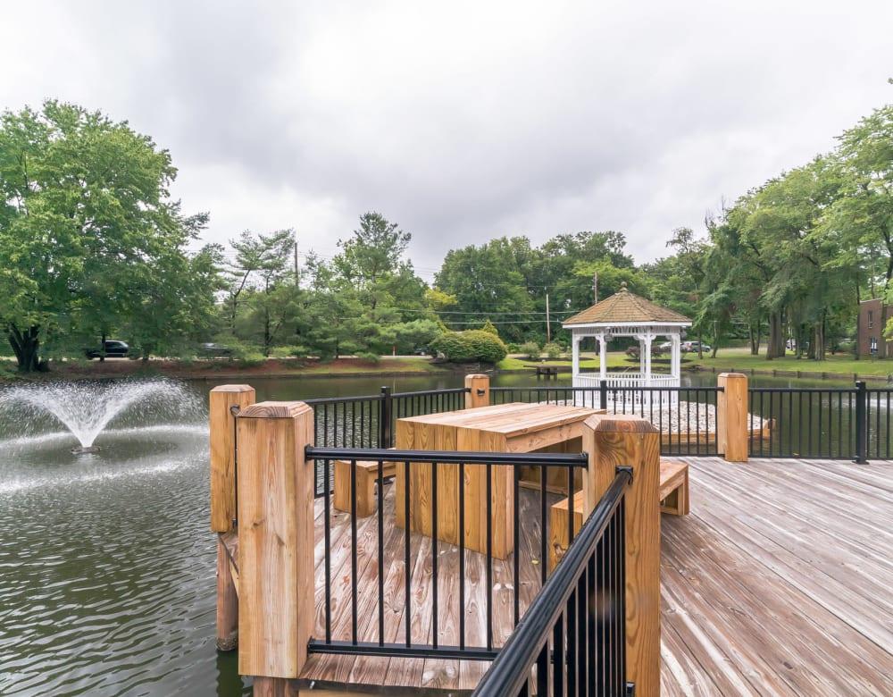 Deck near pond at Ramblewood Village Apartments in Mount Laurel, New Jersey