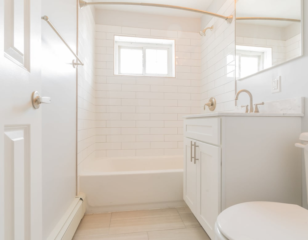 Clean bathroom at Eagle Rock Apartments at Carle Place in Carle Place, New York