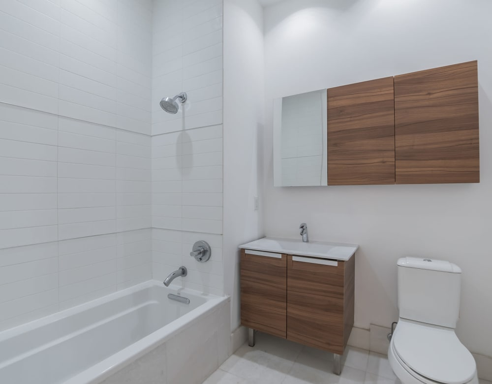 Bathroom with wooden accents at Monarch at Ridge Hill in Yonkers, New York