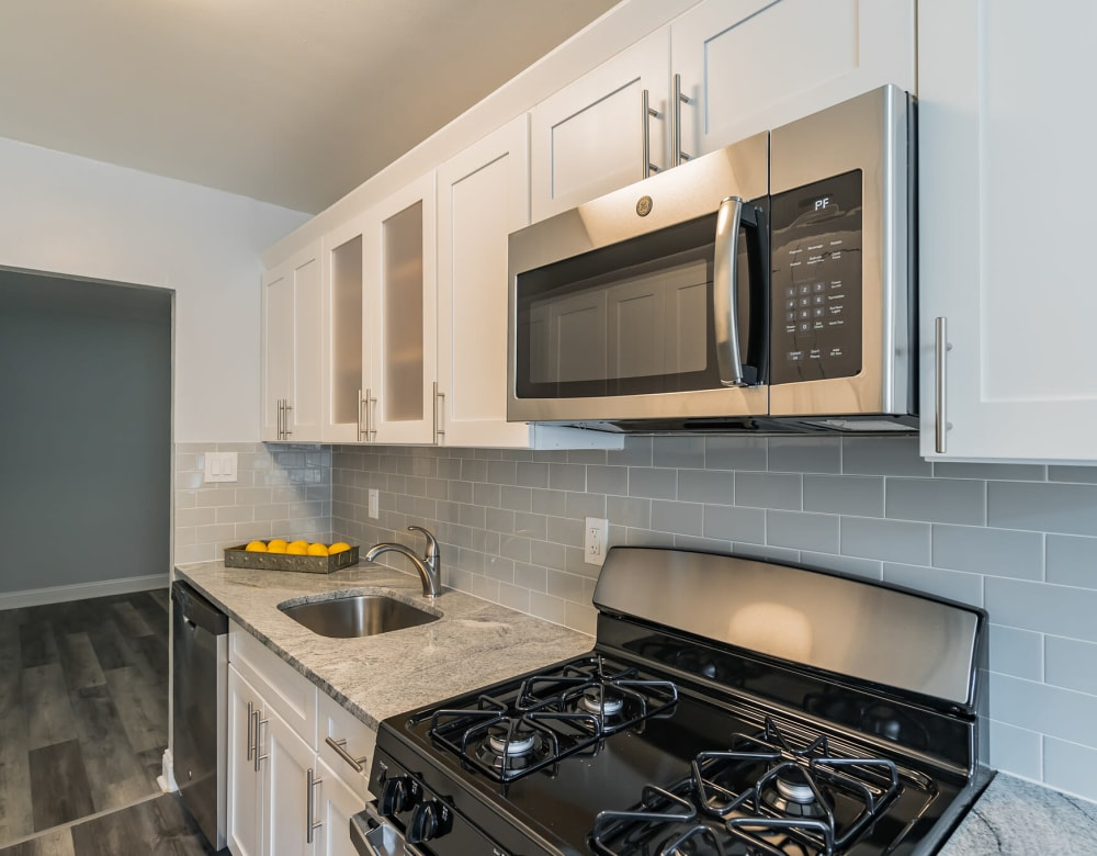 Kitchen featuring stainless steel appliances at Bergen Apartments in Freeport, New York