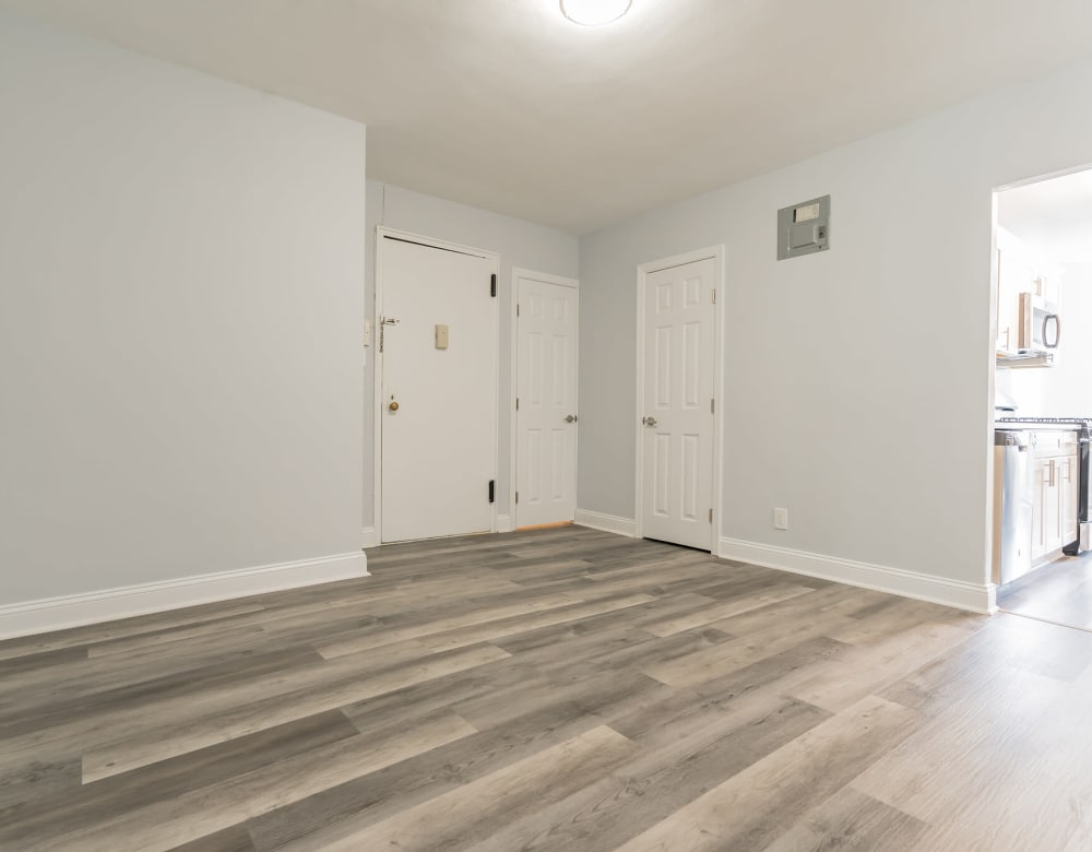 Apartment entrance into open floor plan living room at Bergen Apartments in Freeport, New York