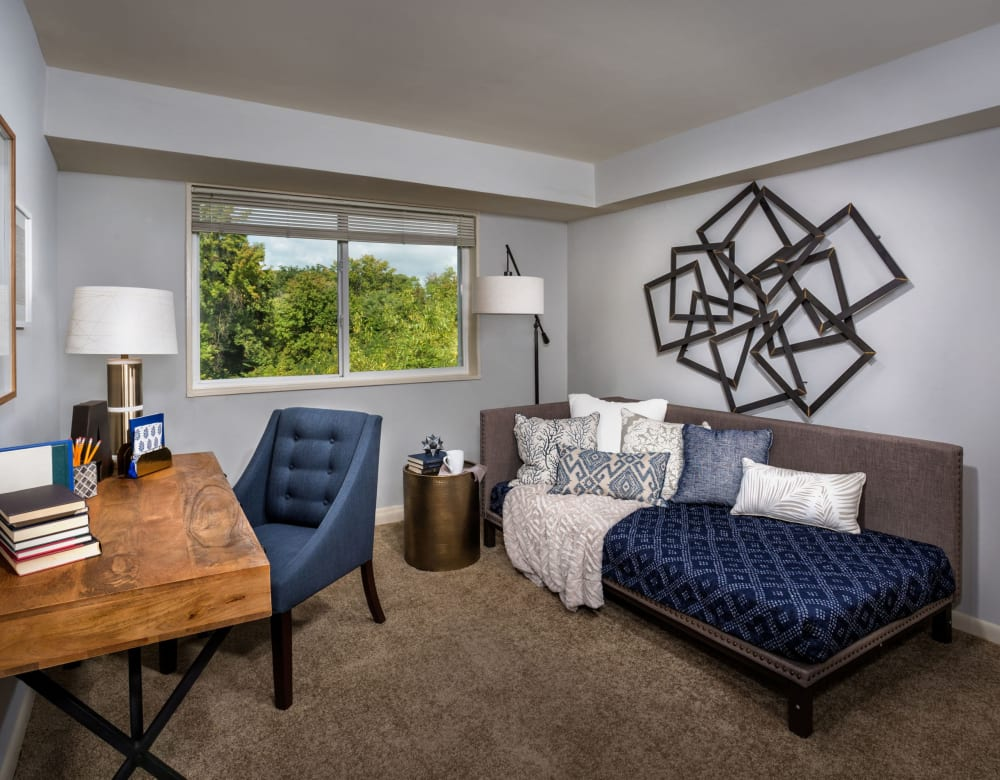 Spacious living room with wood-style flooring and modern decorations at Admiral Place Apartments in Suitland, Maryland