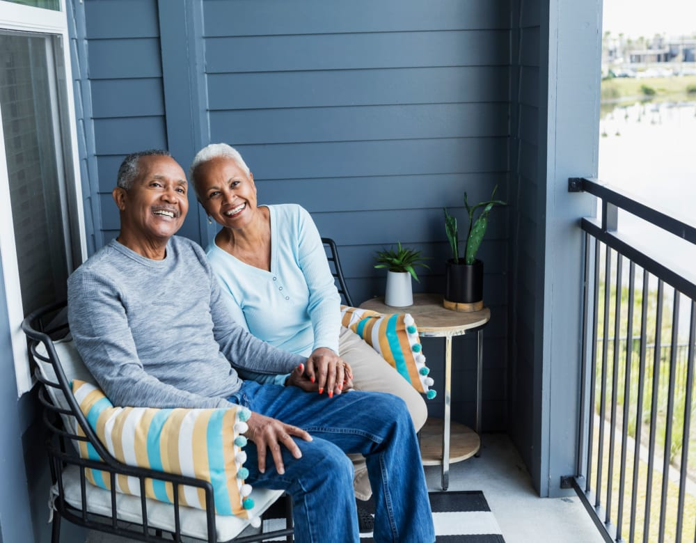 Residents enjoying balcony at Admiral Place Apartments in Suitland, Maryland