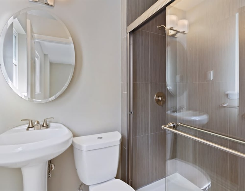 Shower and cute vanity circle mirror at Eagle Rock Apartments at North Plainfield in North Plainfield, New Jersey