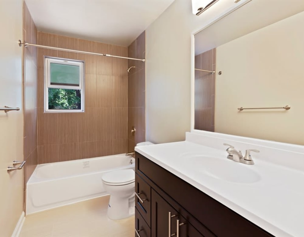 Bathroom with large mirror and tub shower combo at Eagle Rock Apartments at North Plainfield in North Plainfield, New Jersey