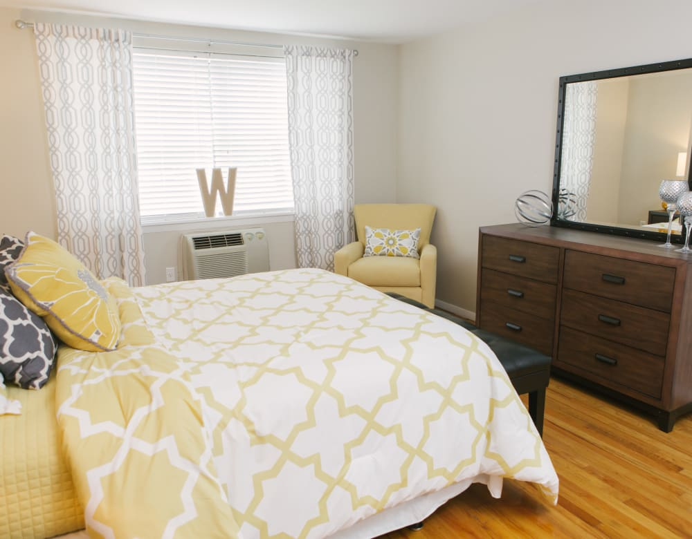 Decorated bedroom with large windows for lots of natural light at Eagle Rock Apartments at West Hartford in West Hartford, Connecticut