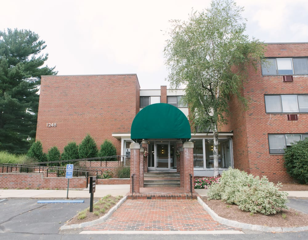 Exterior brick building and entrance to Eagle Rock Apartments at West Hartford in West Hartford, Connecticut