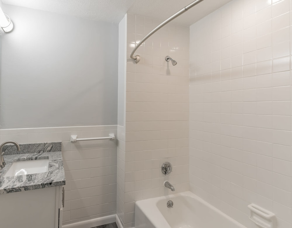 bathroom with granite counters at Park Village West in Westborough, Massachusetts