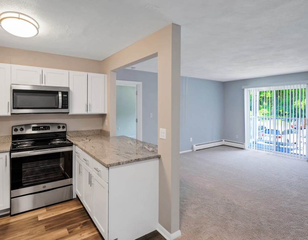 Steel appliance kitchen and spacious living room at Park Village West in Westborough, Massachusetts