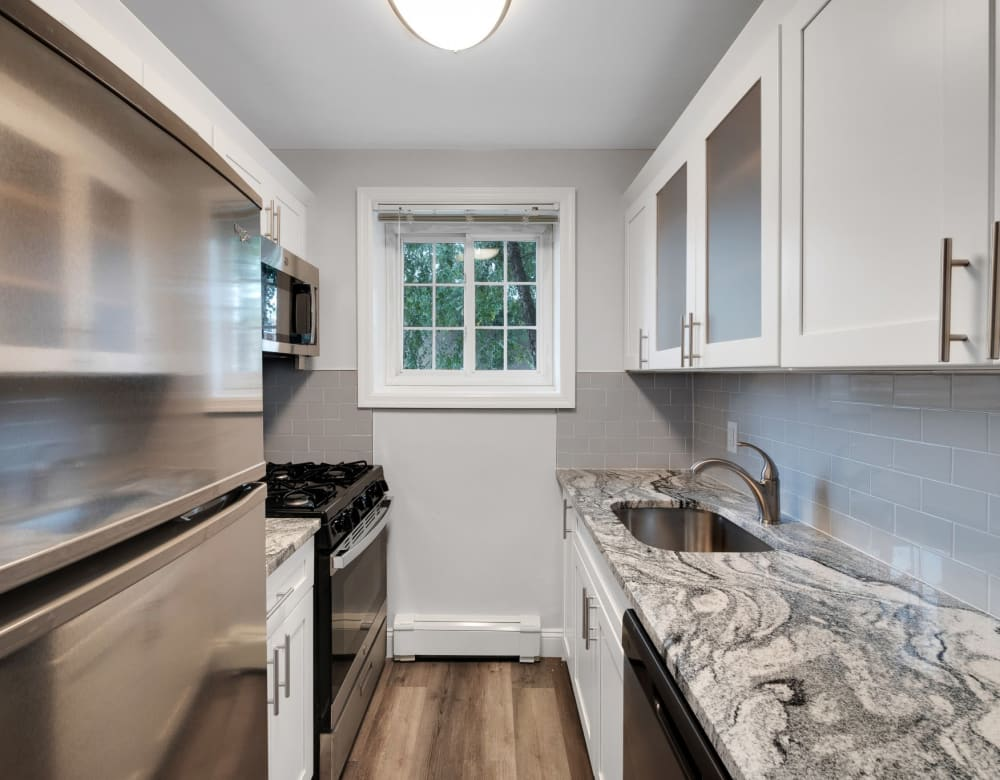 Beautiful kitchens at Eagle Rock Apartments at Carle Place in Carle Place, New York