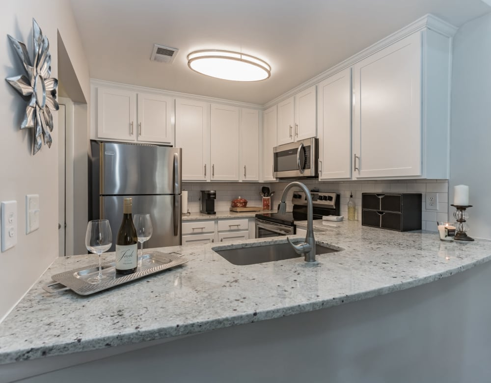 Granite kitchen island in model kitchen at Eagle Rock Apartments at Columbia in Columbia, Maryland