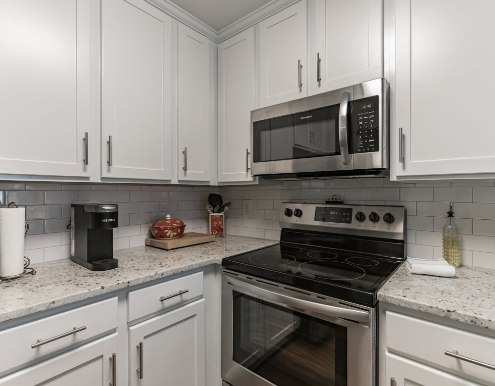 Stainless steel appliances with white cabinetry at Eagle Rock Apartments at Columbia in Columbia, Maryland