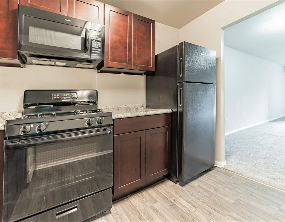 Wood-style flooring in an apartment home's kitchen at Eagle Rock Apartments at Towson in Towson, Maryland