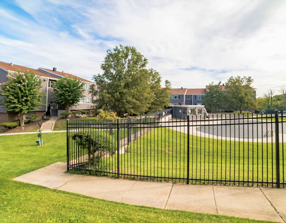 Fenced onsite dog park with ample green grass for your pets to play at Eagle Rock Apartments at Towson in Towson, Maryland