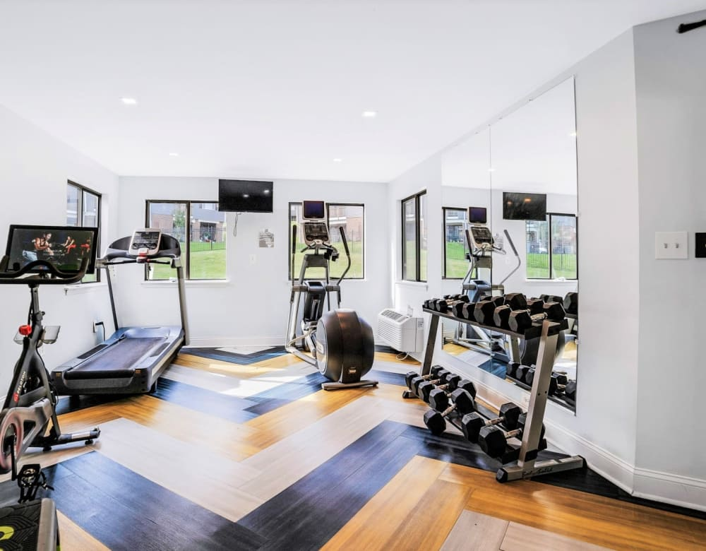 Fitness center with cardio equipment and weights at Eagle Rock Apartments at Towson in Towson, Maryland