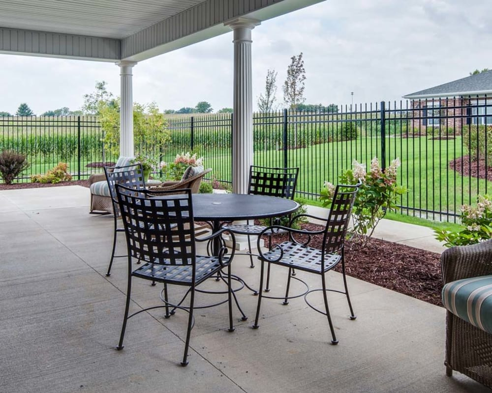 Covered outdoor seating at Ravenwood Terrace Senior Living in Moberly, Missouri