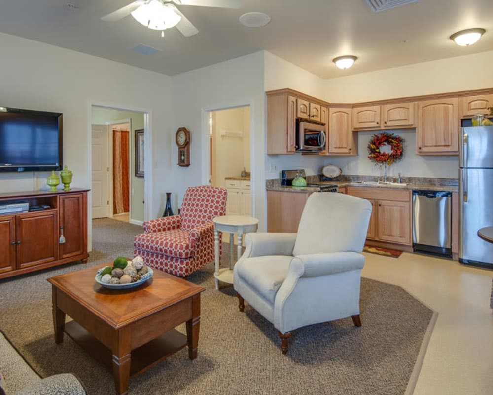 La Bonne Maison Senior Living in Sikeston, Missouri offers a full living room and open kitchen