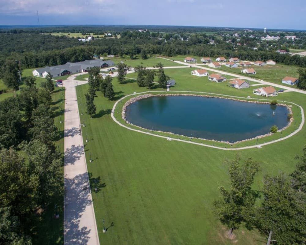 View of Victorian Place of Owensville in Owensville, Missouri and the glistening pond