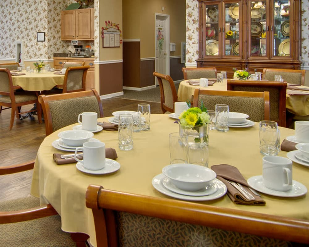 Well decorated dining area table at South Pointe Senior Living in Washington, Missouri