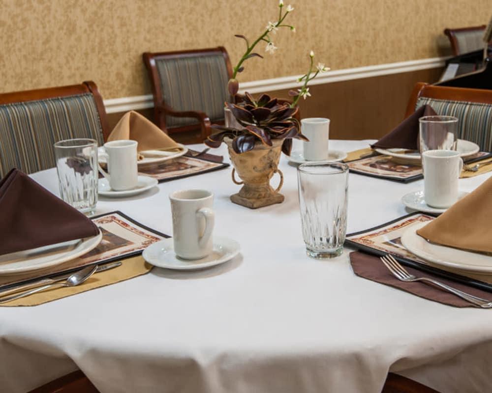 Well decorated dining area table at Maplebrook Senior Living in Farmington, Missouri