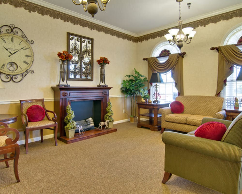Cozy lounge area with a fireplace at Ravenwood Senior Living in Springfield, Missouri