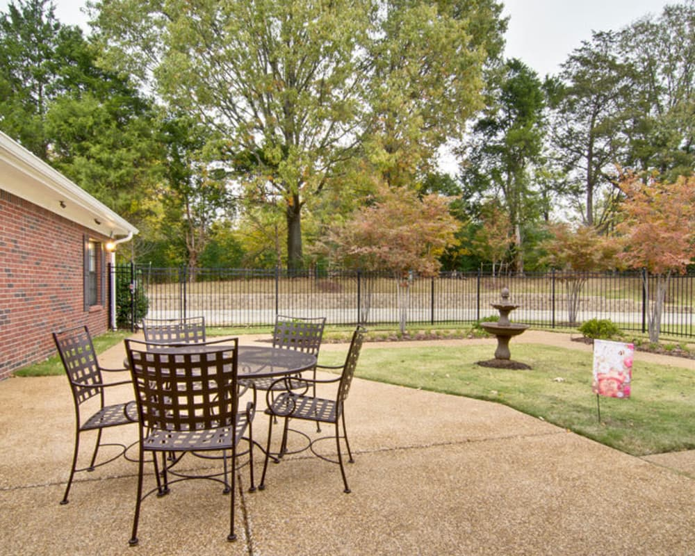Outdoor seating on the back patio at Olive Grove Terrace Senior Living in Olive Branch, Mississippi