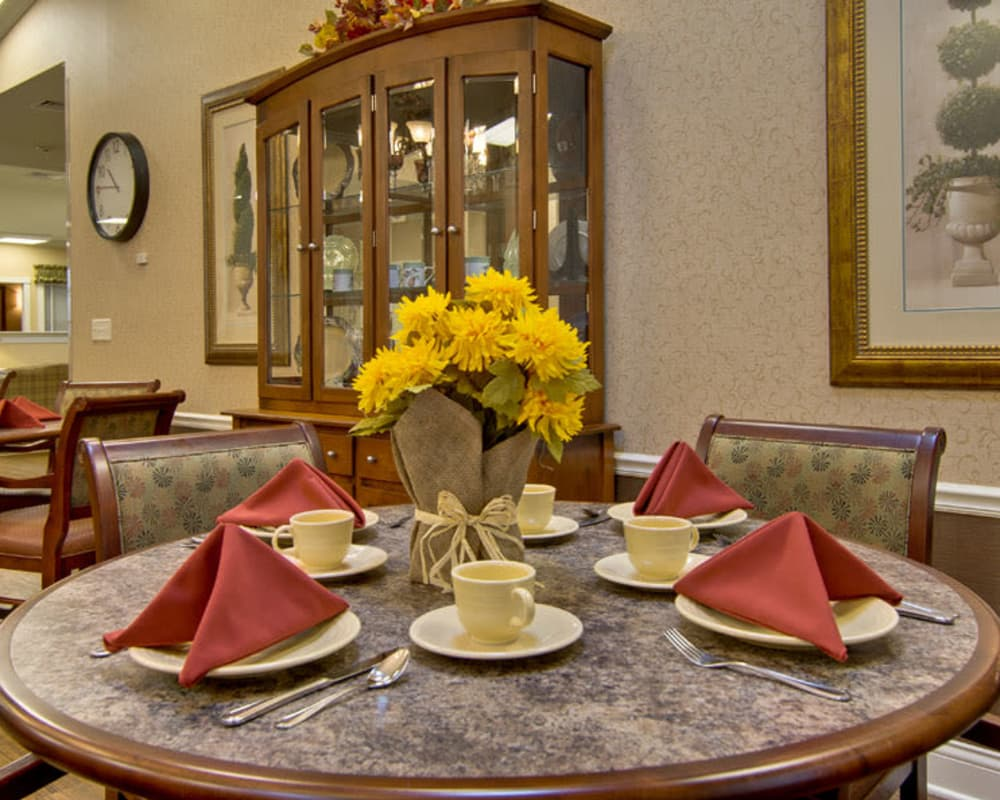 Well decorated dining area table at Olive Grove Terrace Senior Living in Olive Branch, Mississippi