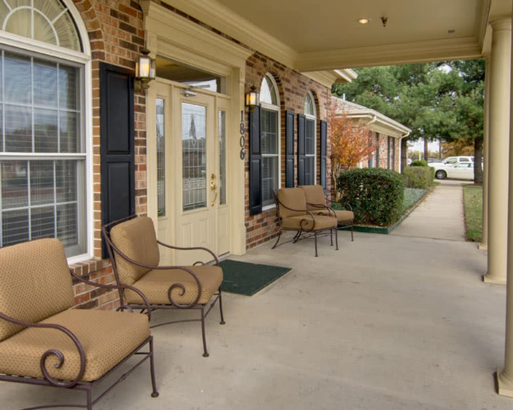 Covered outdoor seating on the front porch at St. Francis Park Senior Living in Kennett, Missouri