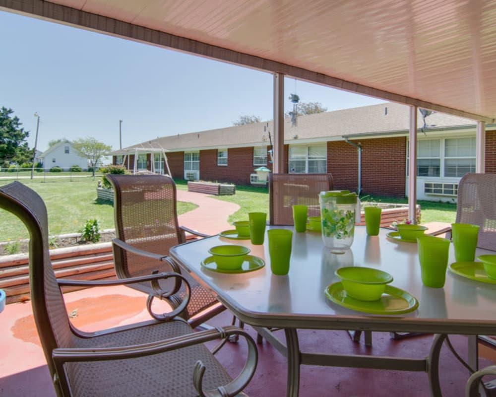 Covered outdoor seating at Moran Manor in Moran, Kansas