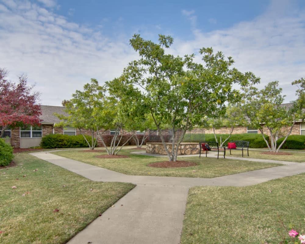 Backyard landscaping with seating at Heritage Nursing Center in Kennett, Missouri