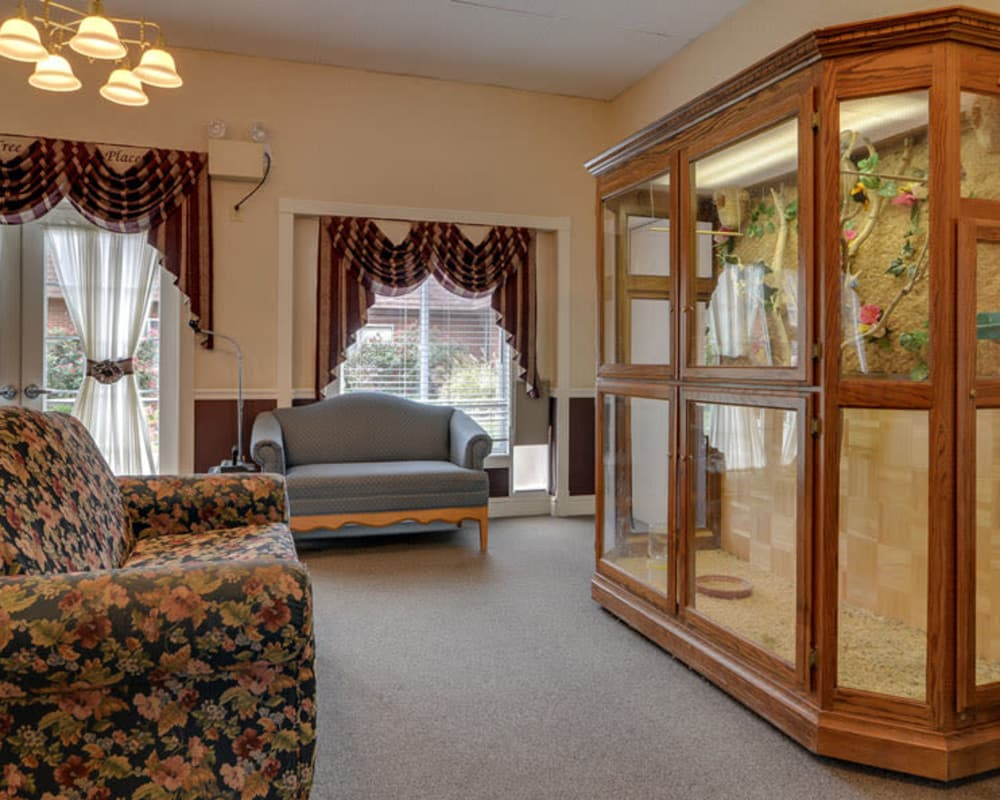 Lounge with an aviary at Birch Tree Place in Birch Tree, Missouri