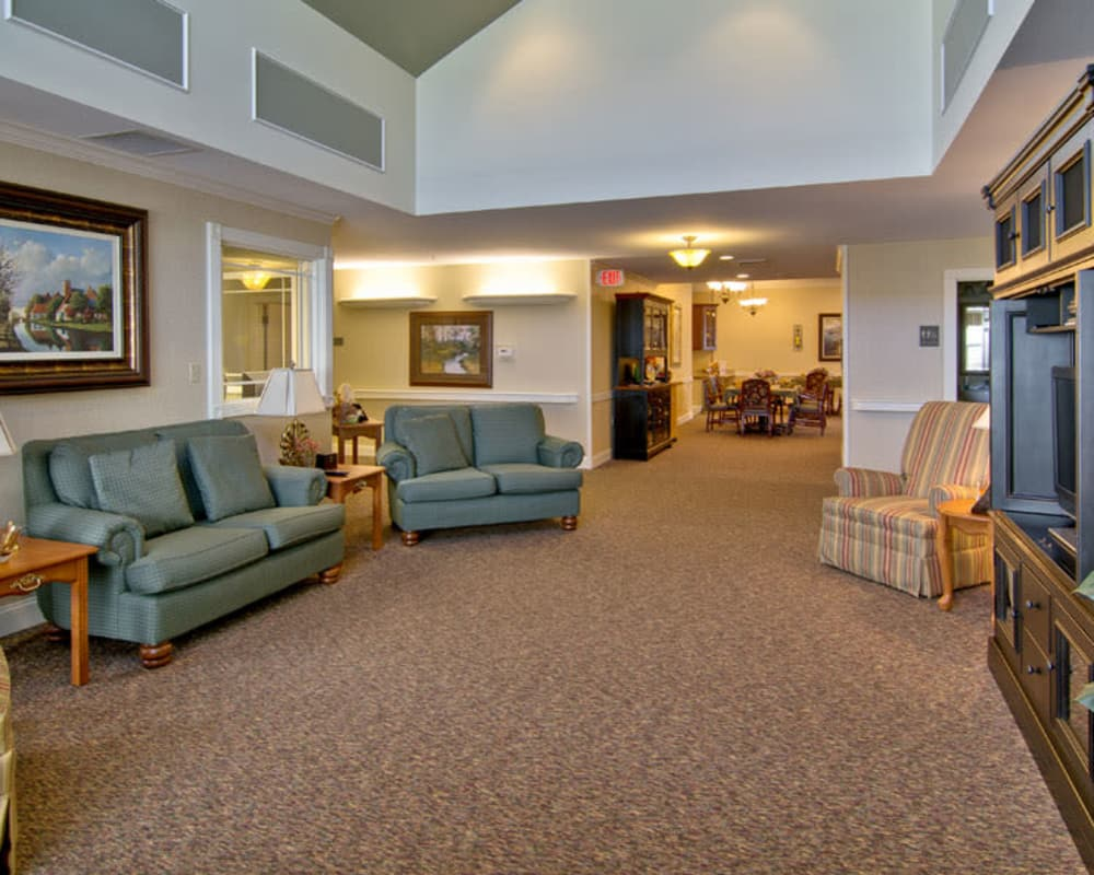 Cozy entertainment room at The Neighborhoods at Quail Creek in Springfield, Missouri