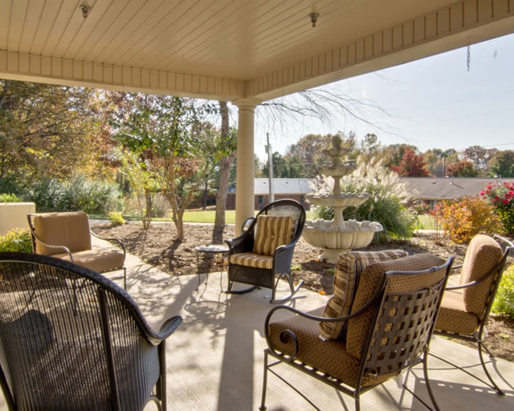 Covered back porch with seating at Greenbrier Meadows in Martin, Tennessee
