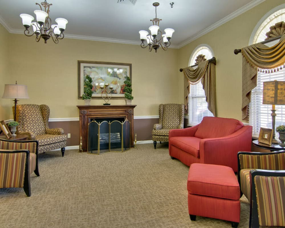 Cozy lounge area with fireside seating at Greenbrier Meadows in Martin, Tennessee