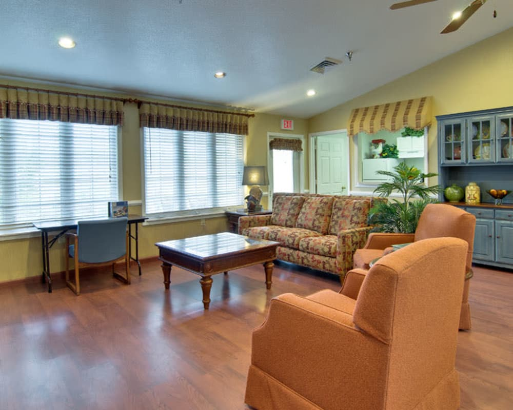Game room with comfortable seating at NorthRidge Place in Lebanon, Missouri