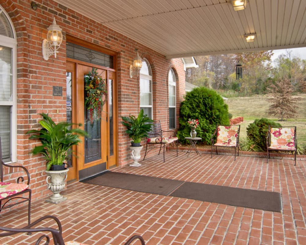 Covered patio with seating at Harmony Hill in Huntingdon, Tennessee