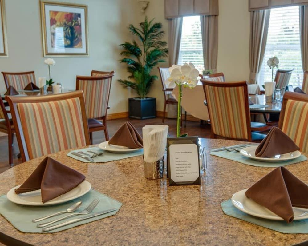 Well decorated dining area table at Victorian Place of Union in Union, Missouri