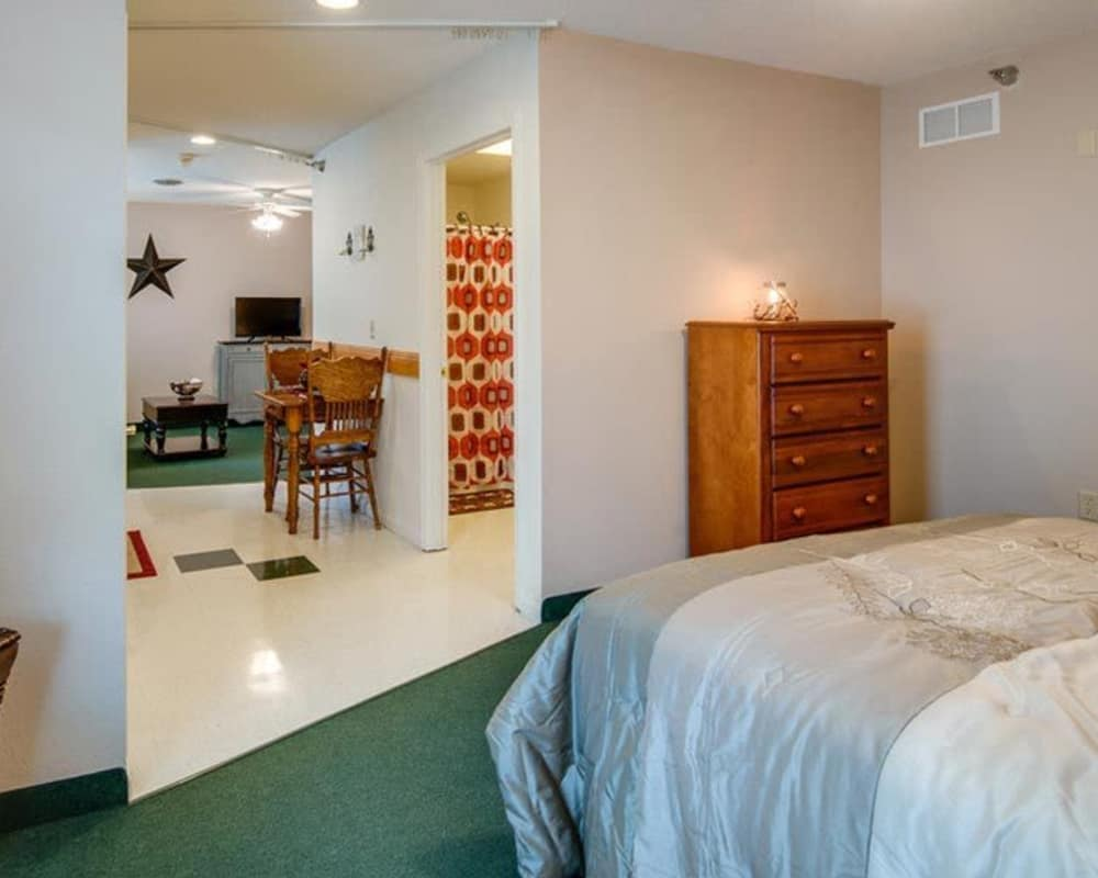 Spacious Assisted Living bedroom at Victorian Place of Sullivan in Sullivan, Missouri