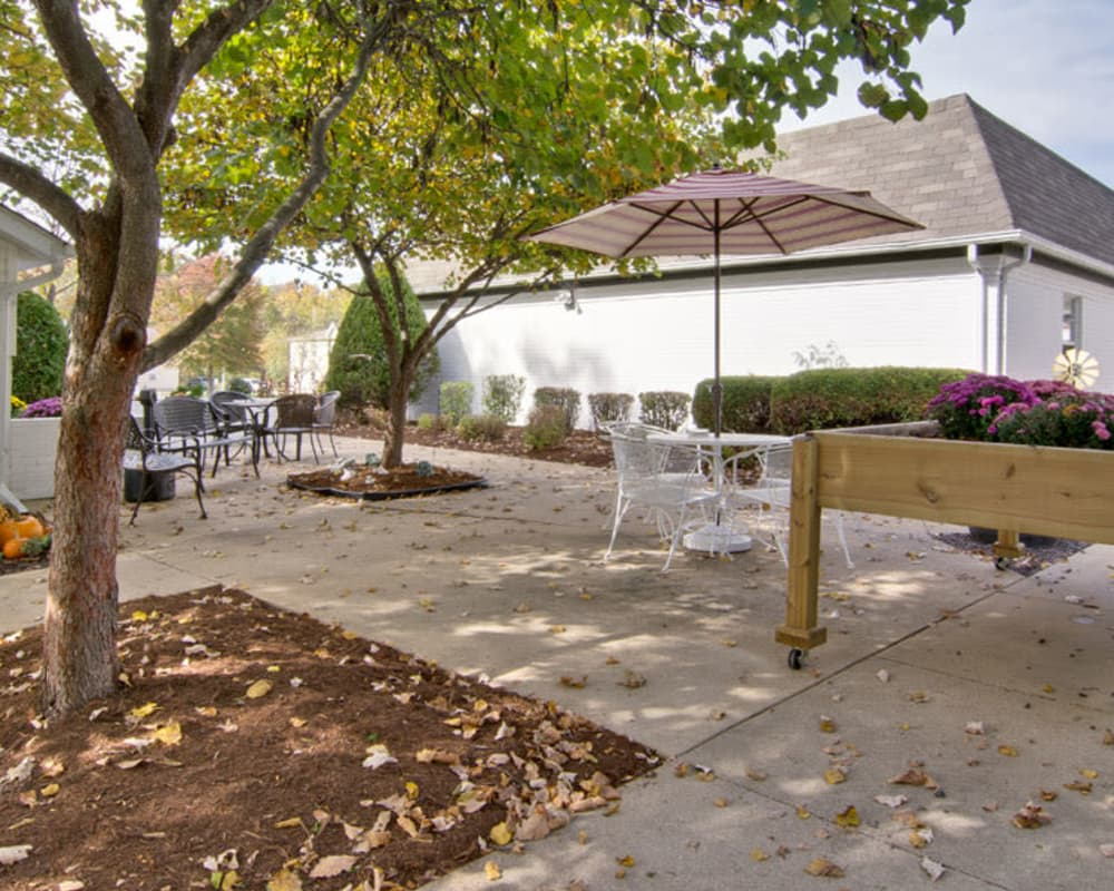Patio with seating and a planter box at Willow Brooke in Union, Missouri