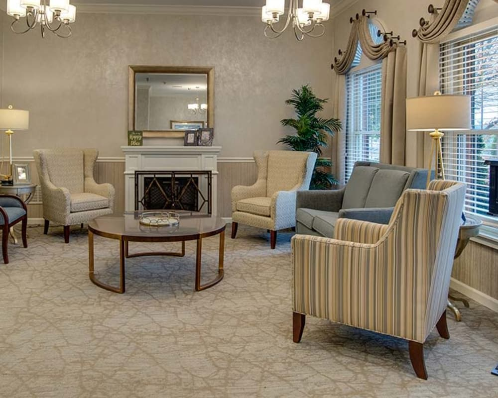 Cozy fireside lounge area at NorthPark Village Senior Living in Ozark, Missouri