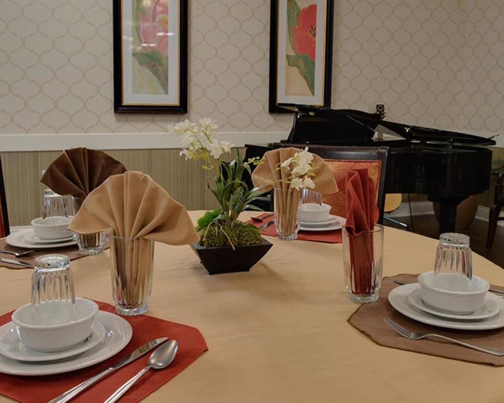 Well decorated dining area table at Mill Creek Village in Columbia, Missouri