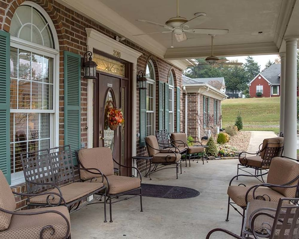 Covered patio with seating at the entrance of Dogwood Pointe in Milan, Tennessee