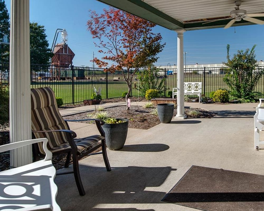Covered outdoor seating at The Arbors at WestRidge Place Senior Living in Sikeston, Missouri