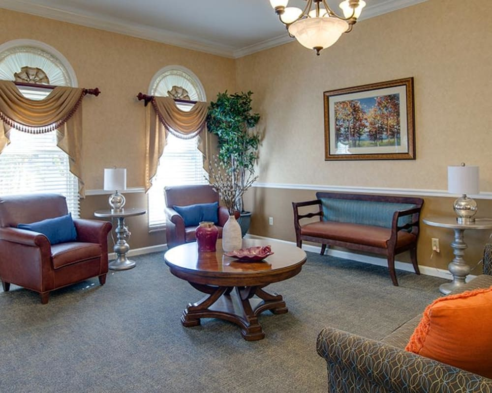 Cozy reading lounge area at The Arbors at WestRidge Place Senior Living in Sikeston, Missouri