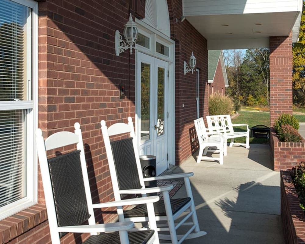 Porch seating in front of Victorian Place of Washington Senior Living in Washington, Missouri
