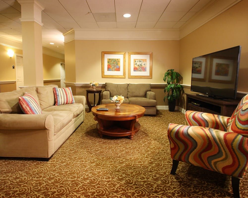 Spacious common room with couches at Wyndham Court of Plano in Plano, Texas