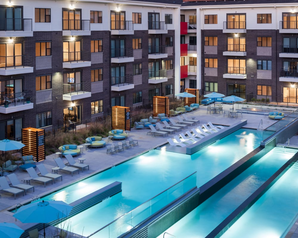 Evening view of swimming pool area at Axis 3700 in Plano, Texas