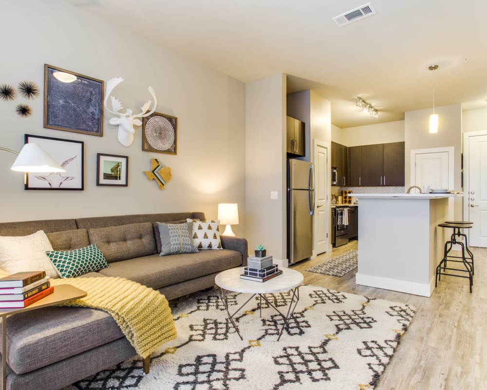 Bright living room at Maple District Lofts in Dallas, Texas
